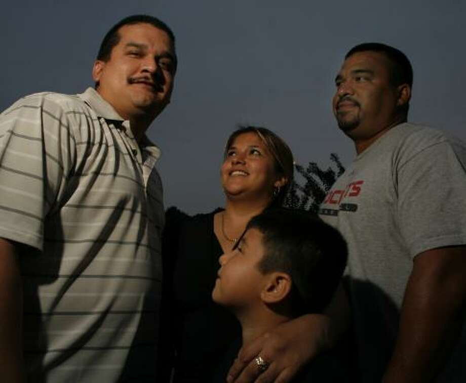 Gilbert Amezquita, 30, left, visits with his sister, Gracie Amezquita and her son, Eric Amezquita, 6, and his brother Ramiro Amezquita, on Friday. Gilbert Amezquita spent eight years in prison. Photo: STEVE UECKERT, CHRONICLE