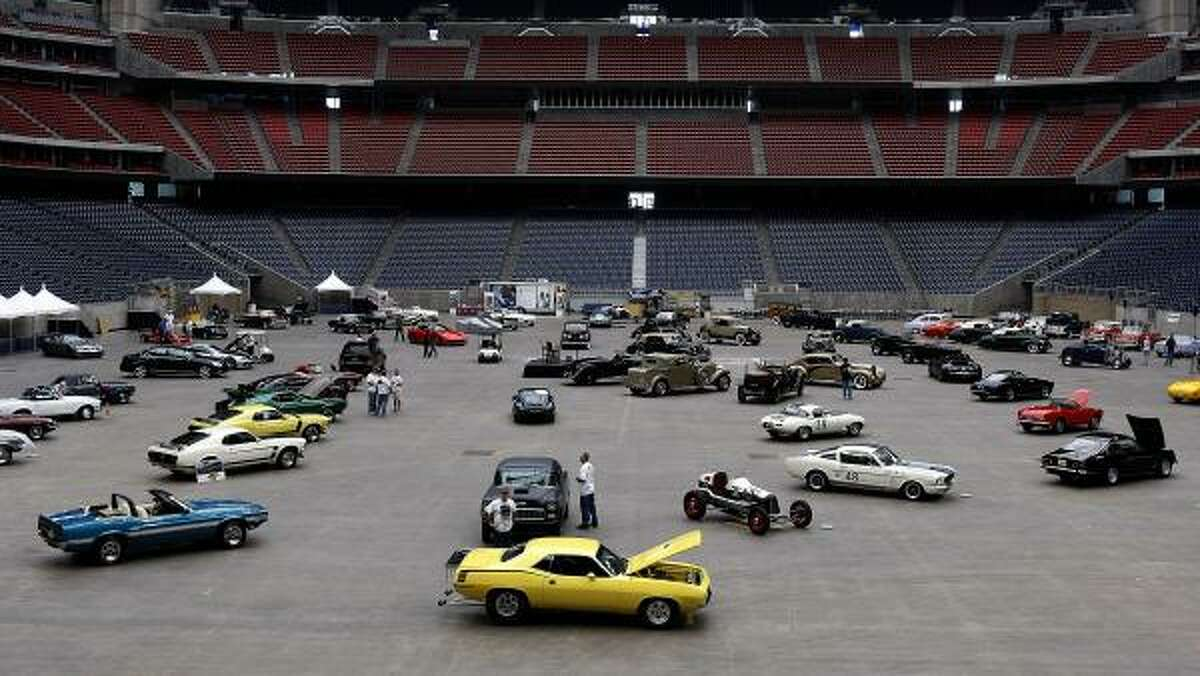 Automobiles arrive before the start of the 8th Annual Classy Chassis Concours d' Elegance at Reliant Stadium. This year's show features
