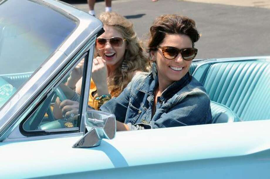 """Taylor Swift and Shania Twain during of a recreation of """"Thelma & Louise"""" days prior. The clip played at the beginning of the awards ceremony. Photo: Rick Diamond, Getty"""