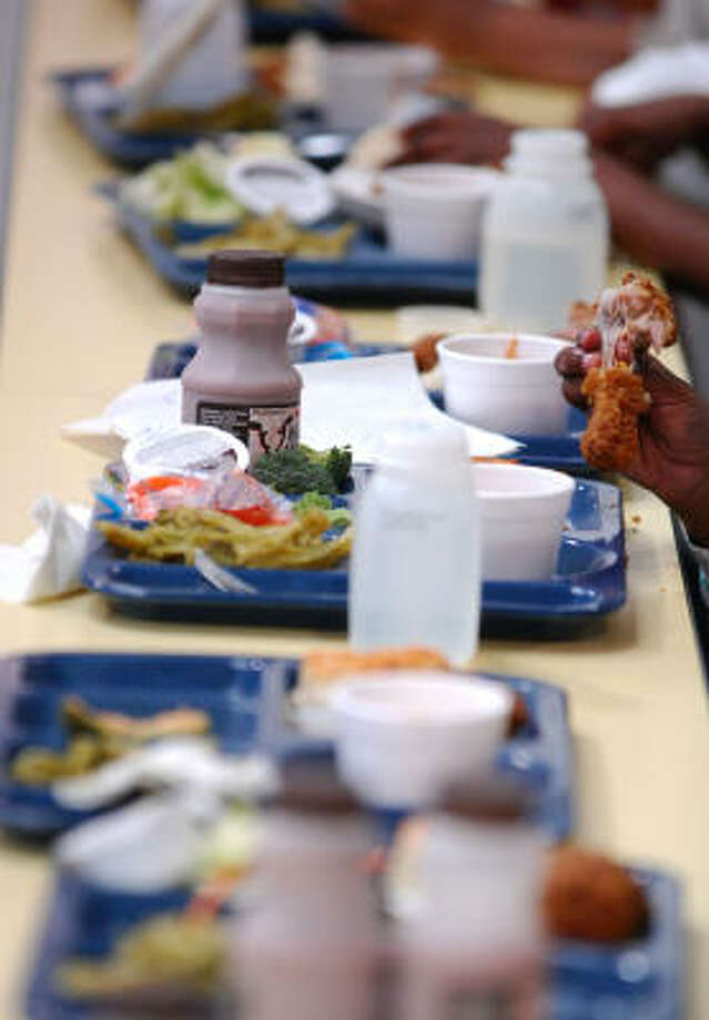 Slow Food USA, a nonprofit that argues for stronger standards for school foods, will be asking potluck participants to sign a petition asking for $1 more per child for lunch. Photo: JEFF GENTNER, ASSOCIATED PRESS