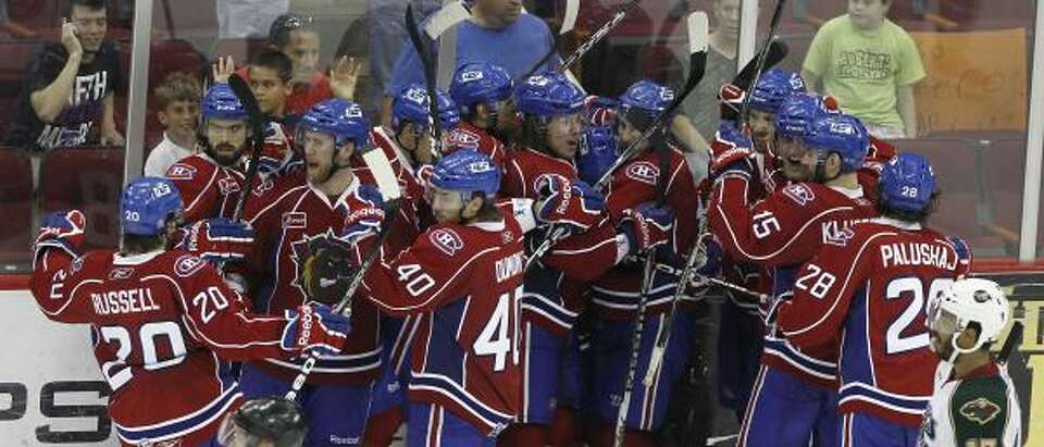 The Hamilton Bulldogs celebrate after beating the Aeros in Game 6 of the Western Conference finals.