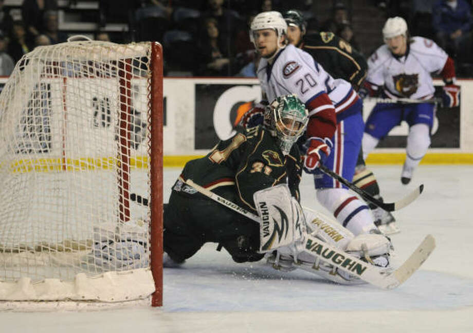 Hamilton's Ryan Russell scores a third-period goal on Aeros goalie Matt Hackett on Friday night. Photo: Kaz Novak, The Hamilton Spectator