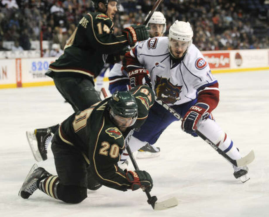 Aeros center Chad Rau, bottom, and Hamilton's Dustin Boyd battle for the puck in the third period. Photo: Kaz Novak, The Hamilton Spectator