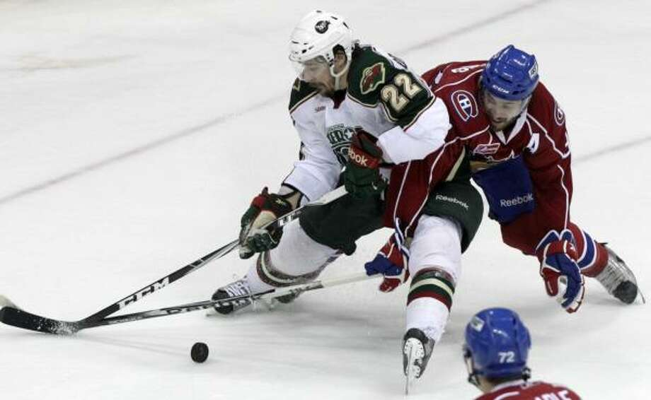 Aeros right wing Jed Ortmeyer (22) gets tangled up with Bulldogs defensemen Frederic St. Denis as they fight for possession in the first period of Tuesday's game at Toyota Center. Photo: Cody Duty, Chronicle