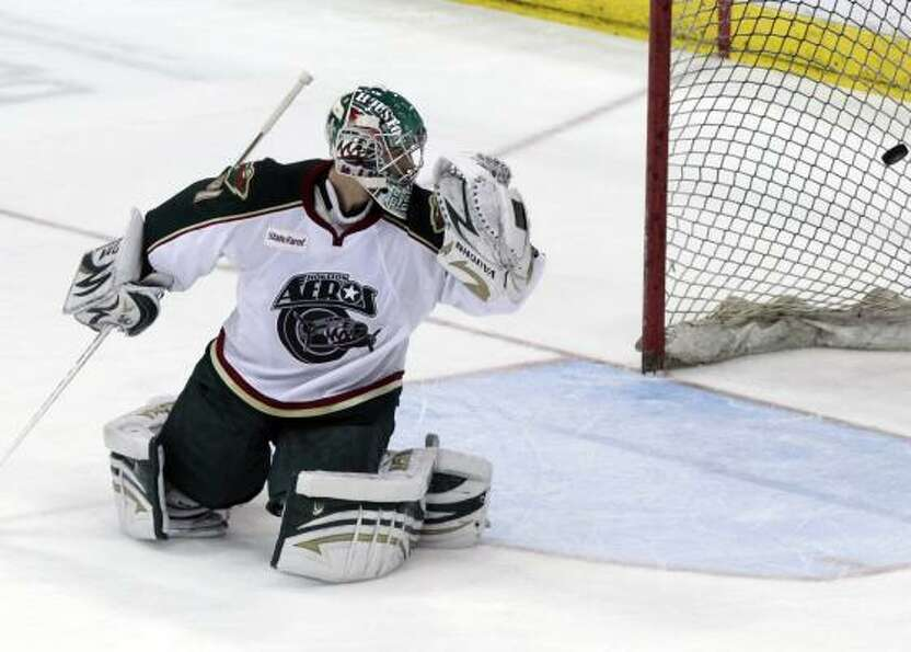Aeros goalie Matt Hackett watches a shot from Bulldogs defenseman Mathieu Carle slip past his glove