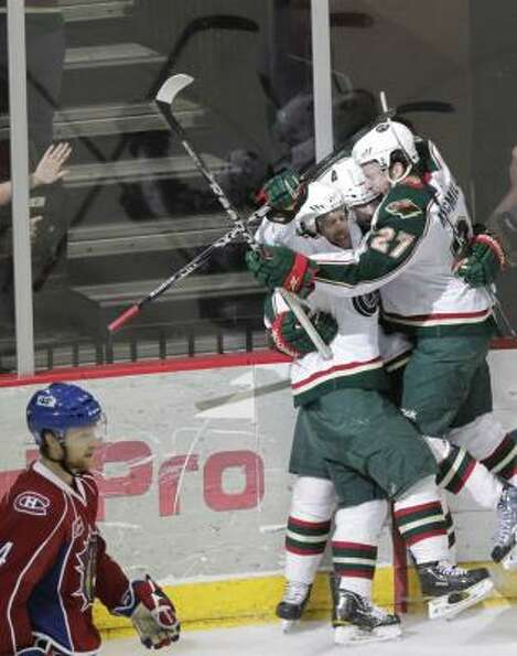 The Aeros celebrate after center Casey Wellman scores a goal on Bulldogs goalie Drew MacIntyre  in t