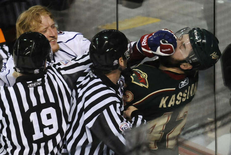 Bulldogs' Andrew Conboy pokes Aeros Matt Kassian during a third-period altercation.  Both received minor penalties after the pushing and shoving was over. Photo: John Rennison, The Hamilton Spectator