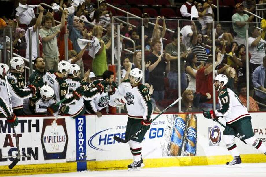 Western Conference finals Game 2: Aeros 3, Bulldogs 2 (Aeros lead 2-0)Center Cody Almond (12) gets high-fives after the Aeros scored in Sunday's match at the Toyota Center. Photo: Eric Kayne, For The Chronicle