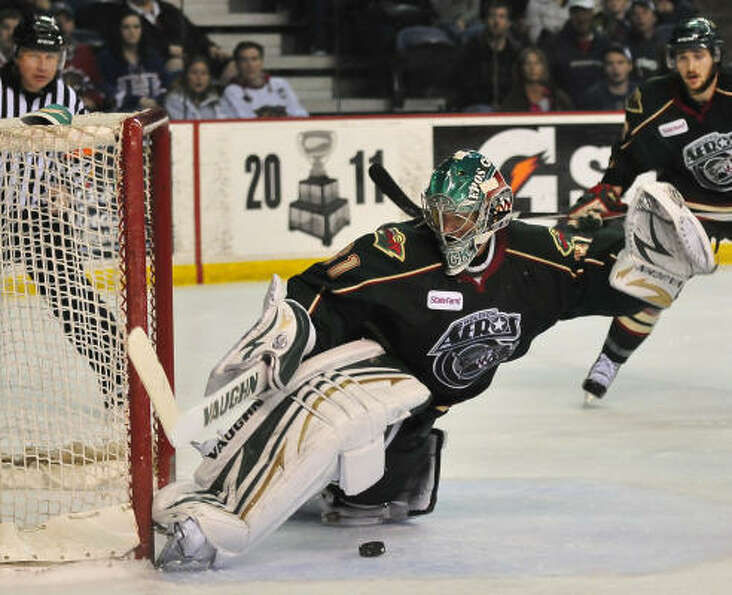 A shot from Hamilton's Andreas Engqvist goes between the legs of Aeros goalkeeper Matt Hackett to ti