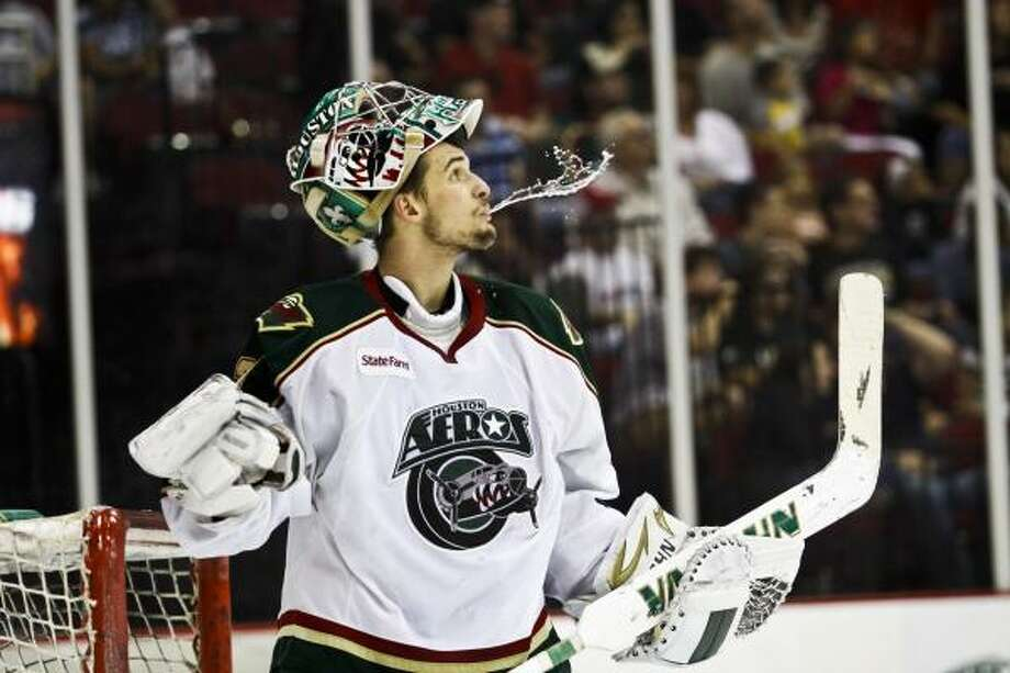 Aeros goalie Matt Hackett drinks water after missing a save. Photo: Eric Kayne, For The Chronicle