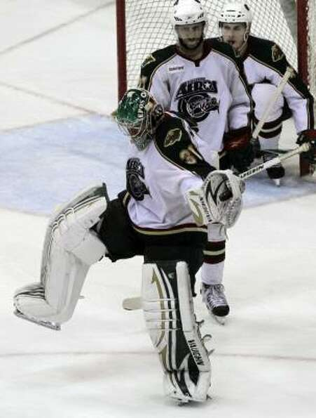Aeros goalie Matt Hackett celebrates with the puck in his glove after catching the final shot of the