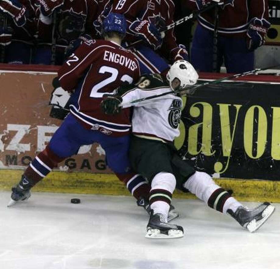 Aeros left wing Colton Gillies, right, is tripped up by Bulldogs center Andreas Engqvist in the third period. Photo: Cody Duty, Chronicle