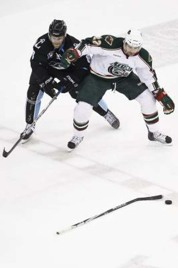 Aeros right wing Jed Ortmeyer, right, loses his stick as Admirals left wing Ryan Thang looks on. Photo: Michael Paulsen, Chronicle