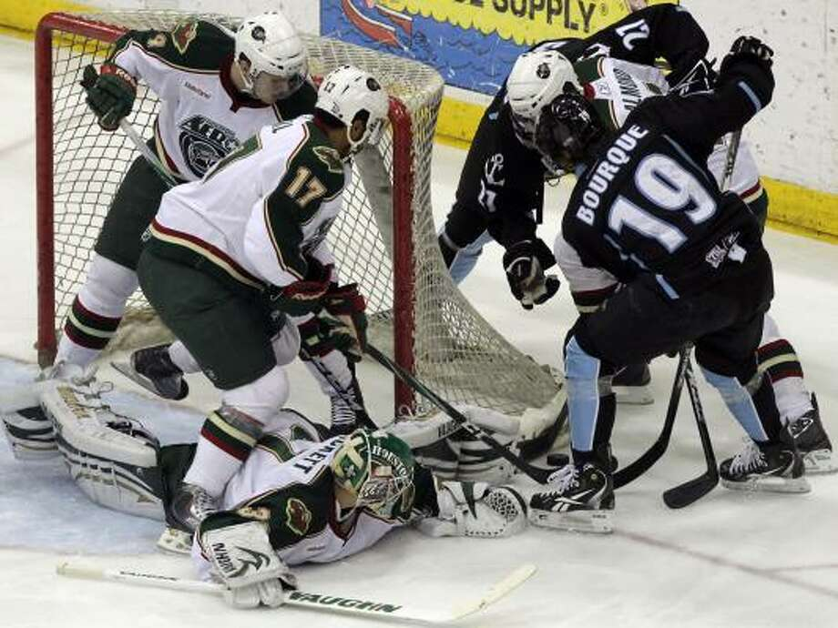 Milwaukee Admirals left wing Gabriel Bourque (19) is stopped by the Houston Aeros defense as he tries to score a goal. Photo: Cody Duty, Chronicle