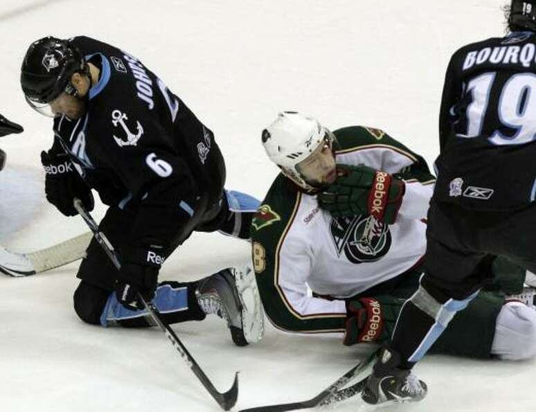 Aeros left wing Colton Gillies (center) falls to the ice after taking a high stick from Milwaukee Ad