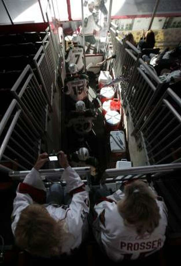 Fans take photos of the Houston Aeros as they take the ice. Photo: Cody Duty, Chronicle