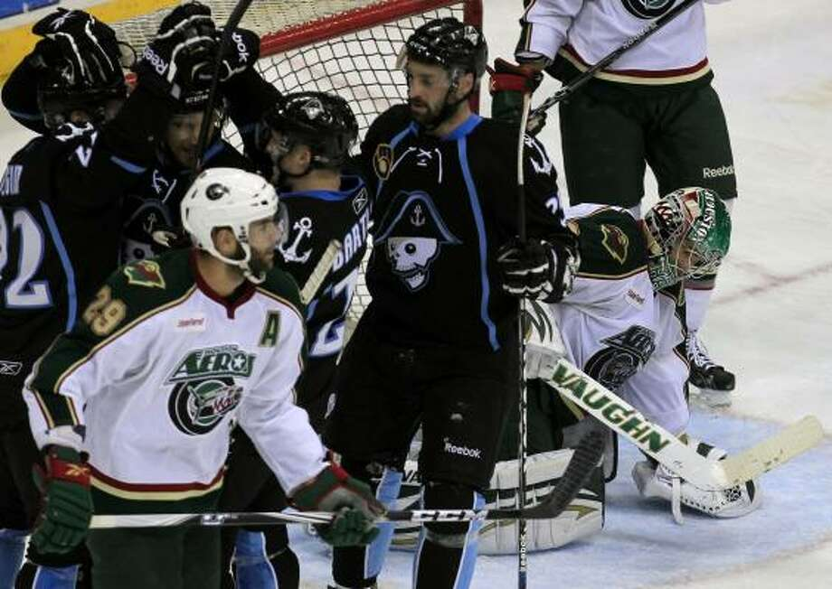 Aeros goalie Matt Hackett, right, lowers his head after giving up a third goal to the Admirals in the second period. Photo: Cody Duty, Chronicle