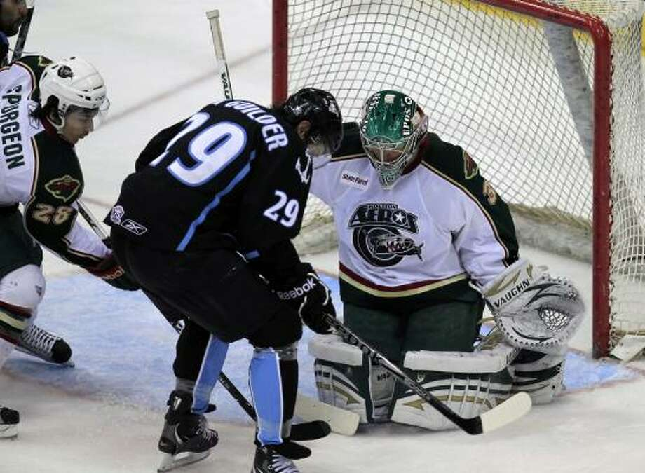 Aeros goalie Matt Hackett blocks a shot attempt from Admirals center Mark Van Guilder in the first period. Photo: Cody Duty, Chronicle