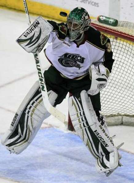 Aeros goalie Matt Hackett blocks a shot attempt in the first period.
