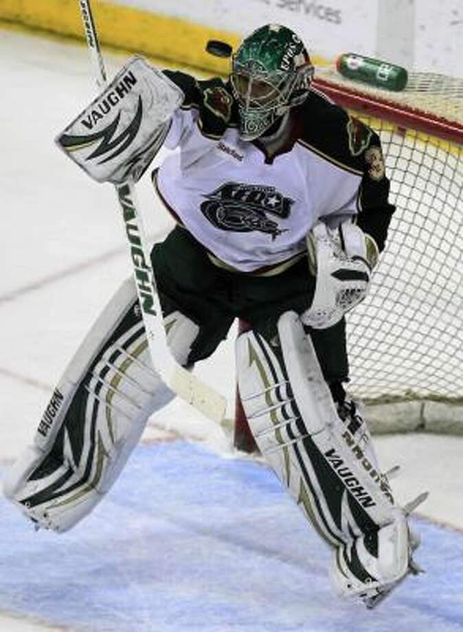 Aeros goalie Matt Hackett blocks a shot attempt in the first period. Photo: Cody Duty, Chronicle