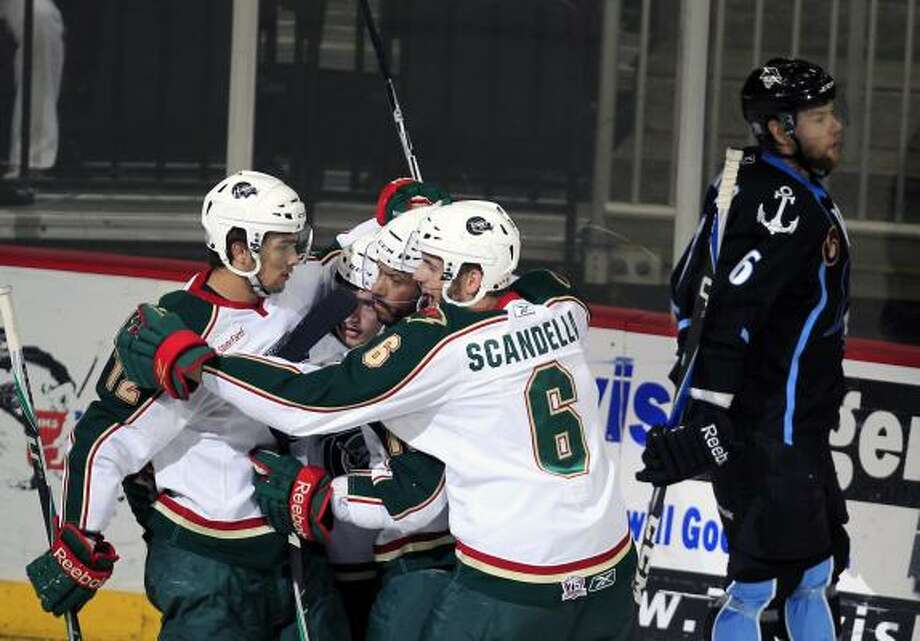 The Aeros celebrate after Jared Spurgeon scored a goal against the Admirals in the first period. Photo: Cody Duty, Chronicle