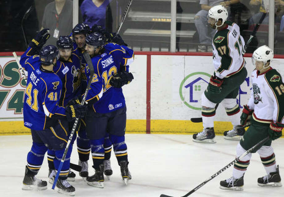 Peoria Rivermen players celebrate a goal by Peoria's Anthony Peluso against the Aeros. Photo: Brett Coomer, Houston Chronicle