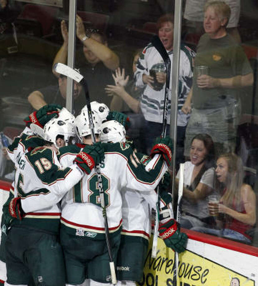 The Aeros celebrate after right wing Jed Ortmeyer (22) scored a goal in the second period. Photo: Cody Duty, Chronicle