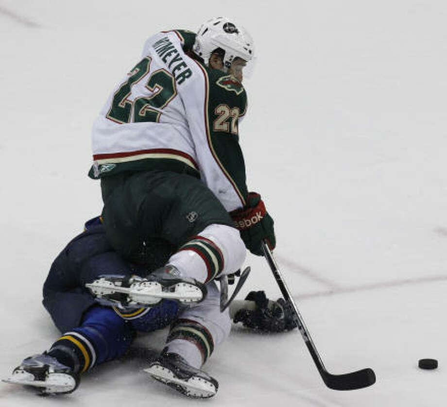 Aeros right wing Jed Ortmeyer (22) falls to the ice as he shoots a goal. Photo: Cody Duty, Chronicle