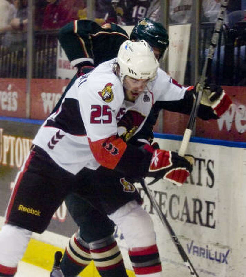 Binghamton Senators' (25) David Dziurzynski and Houston Aeros' (29) Drew Bagnall battle for possession in the first period in game 5 of the Calder Cup Final at the Broome County Veterans Memorial Arena in Binghamton on Saturday, June 4, 2011. Photo: REBECCA CATLETT/ Press & Sun-Bulletin