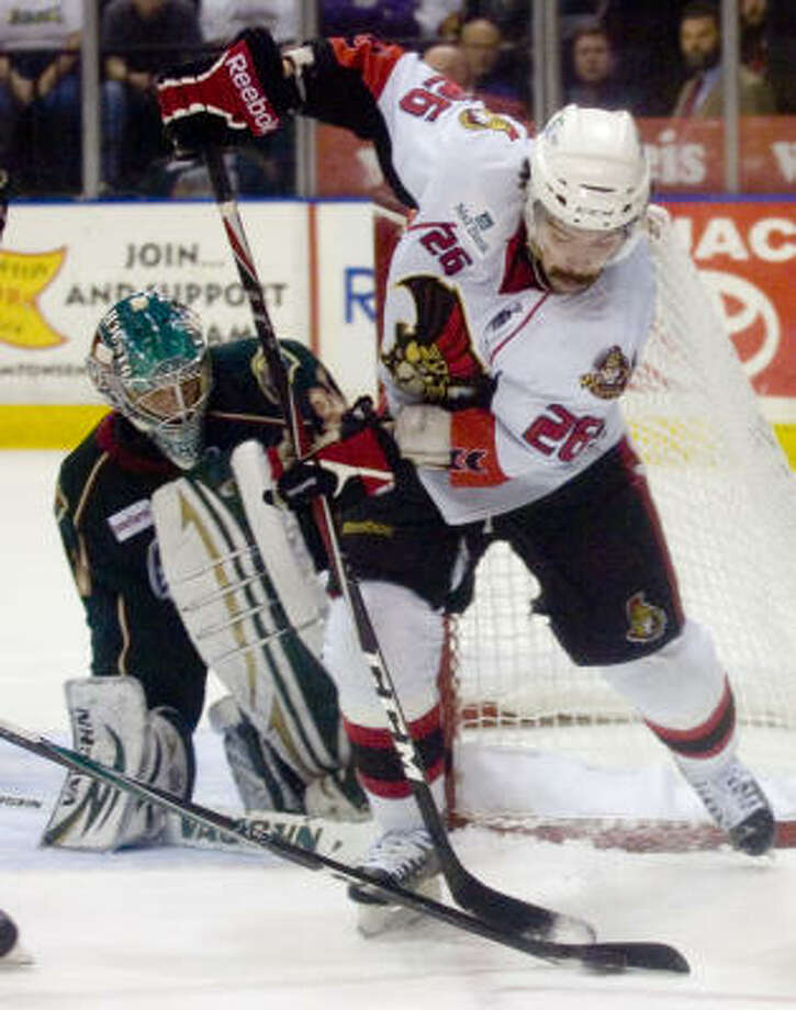 Binghamton Senators' (26) Kaspars Daugavins pressures as Houston Aeros' (31) Matt Hackett blocks the shot. Photo: REBECCA CATLETT/ Press & Sun-Bulletin