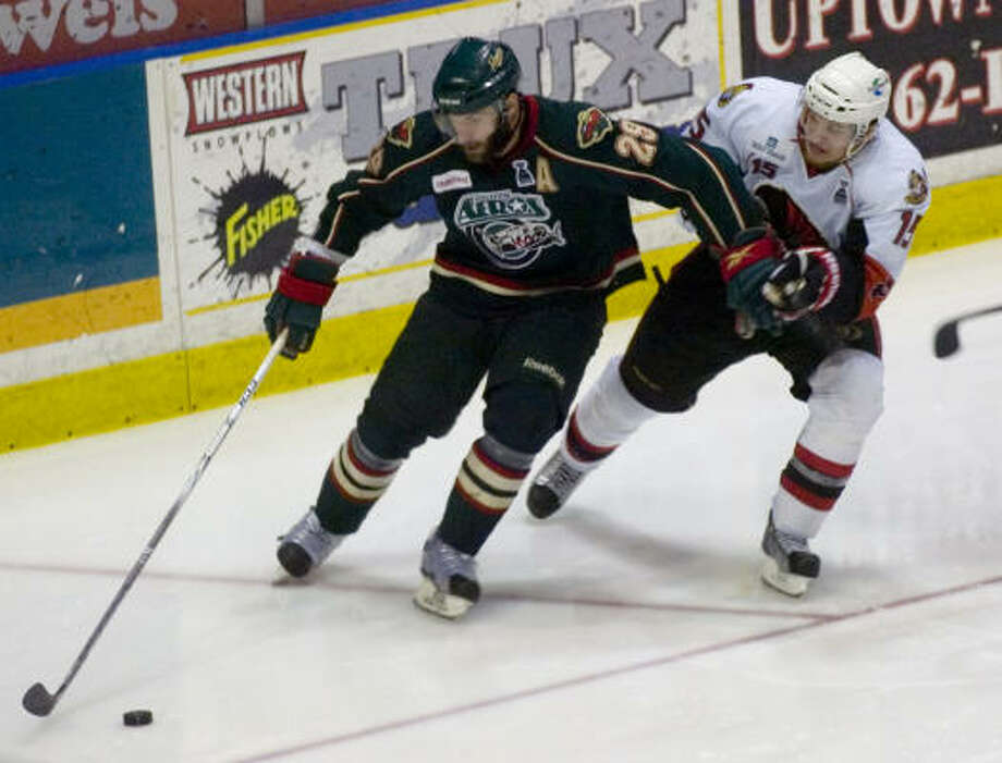 Binghamton Senators' (15) Colin Greening pressures Houston Aeros' (29) Drew Bagnall in the third period. Photo: REBECCA CATLETT/ Press & Sun-Bulletin