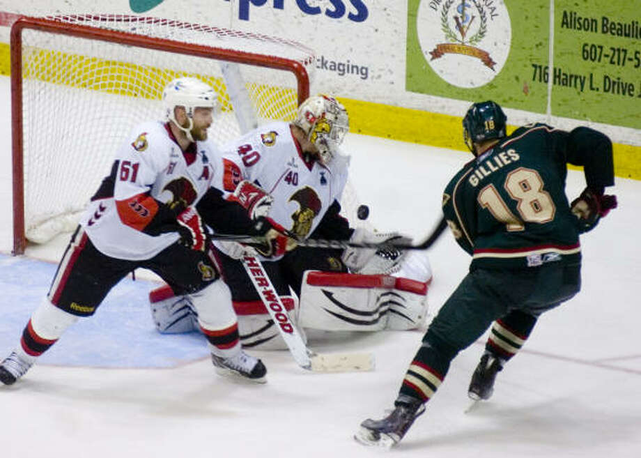 Binghamton Senators' (40) Robin Lehner stops a shot on goal by Houston Aeros' (18) Colton GIllies in the third period . Photo: REBECCA CATLETT/ Press & Sun-Bulletin