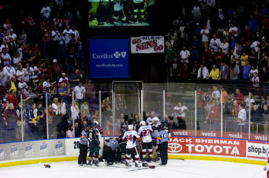 A fight breaks out between the Senators and the Aeros at the end of Friday's game. Photo: REBECCA CATLETT, Press & Sun-Bulletin