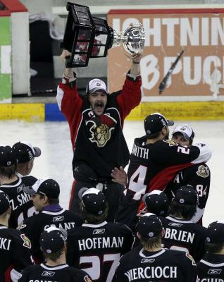 Senators left wing David Dziurzynski holds up the Calder Cup trophy. Photo: Cody Duty, Chronicle