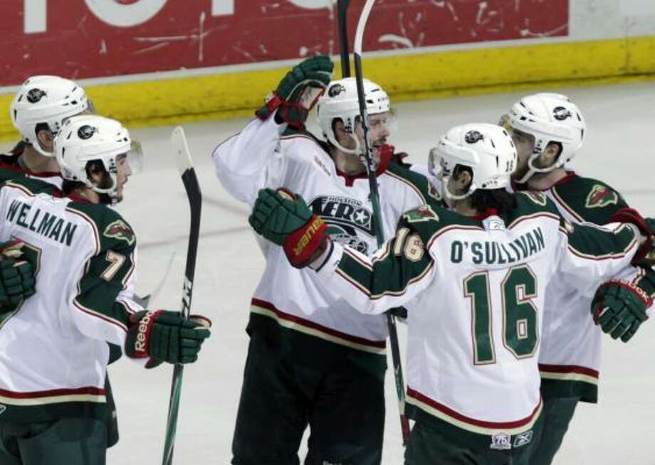 Aeros celebrate after right wing Jon DiSalvatore scored a goal in the second period of game 6 of the Calder Cup Final against the Binghamton Senators at the Toyota Center Tuesday, June 7, 2011, in Houston. Photo: Cody Duty, Chronicle