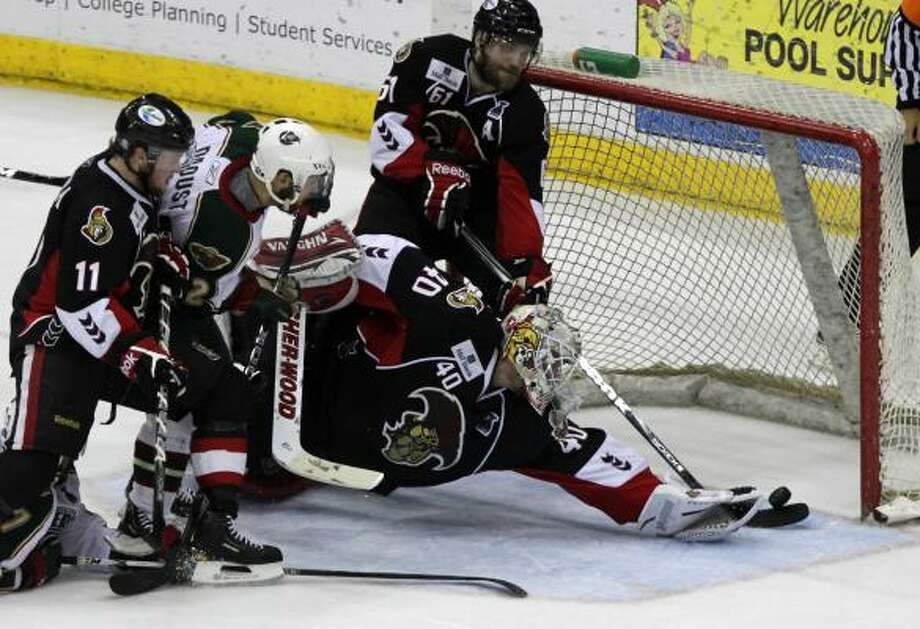 Binghamton Senators goalie Robin Lehner deflects a shot from Houston Aeros right wing Jean-Michel Daoust (62). Photo: Cody Duty, Chronicle