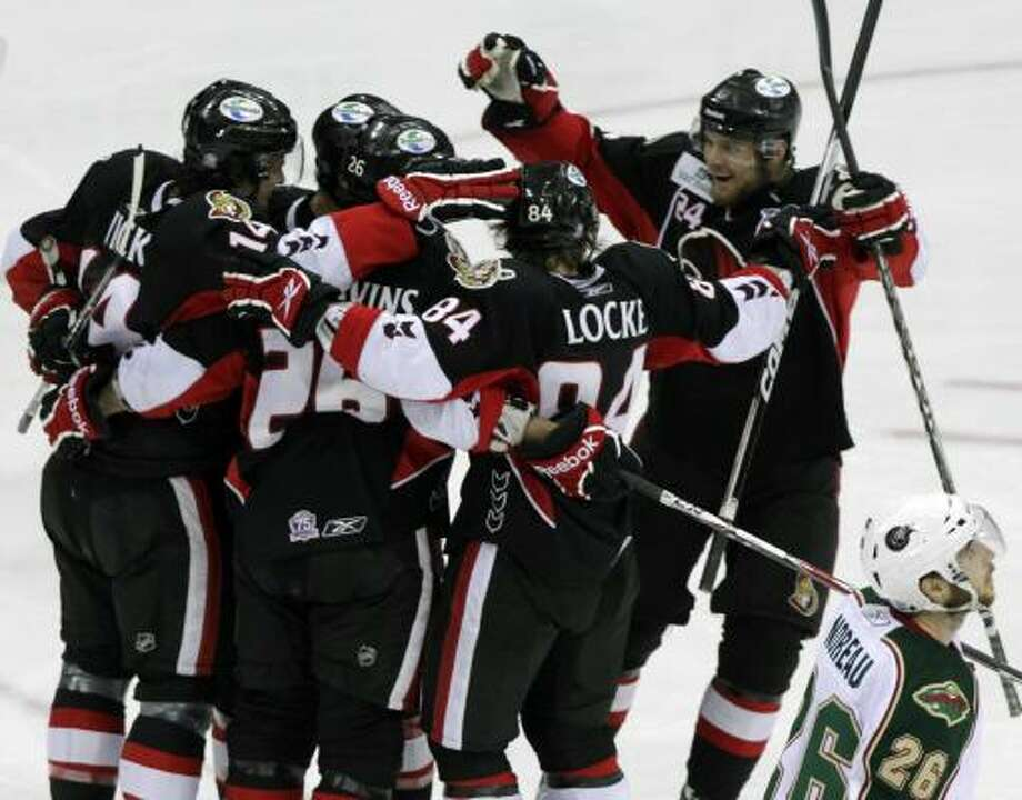 The Binghamton Senators celebrate after Roman Wick scored a goal in the second period. Photo: Cody Duty, Chronicle