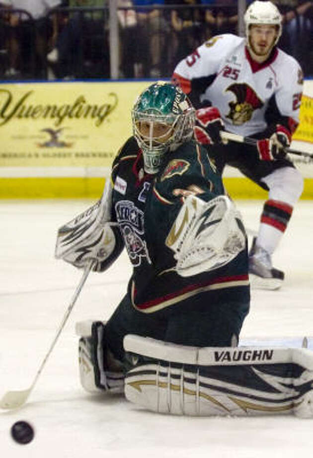 Aeros goalie Matt Hackett deflects a shot in the first period. Photo: REBECCA CATLETT, Press & Sun-Bulletin