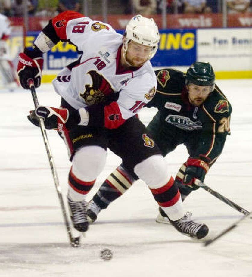 Binghamton Senators' (18) Zack Smith is pressured by Houston Aeros' (20) Chad Rau. Photo: REBECCA CATLETT, Press & Sun-Bulletin