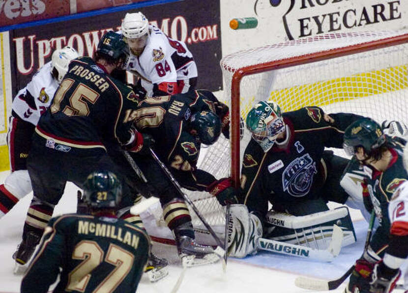 Houston Aeros' (31) Matt Hackett blocks the goal.