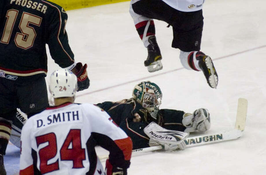 Houston Aeros' (31) Matt Hackett stops a shot on goal. Photo: REBECCA CATLETT, Press & Sun-Bulletin