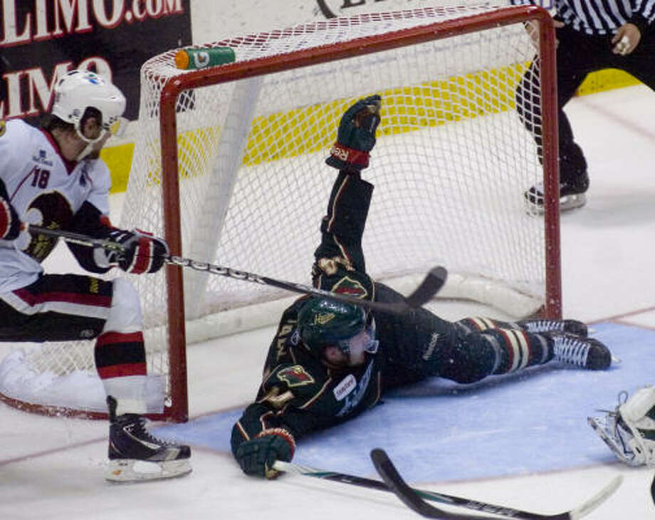 Houston Aeros' (44) Justin Falk blocks an open goal with his body. Photo: REBECCA CATLETT/ Staff Photo