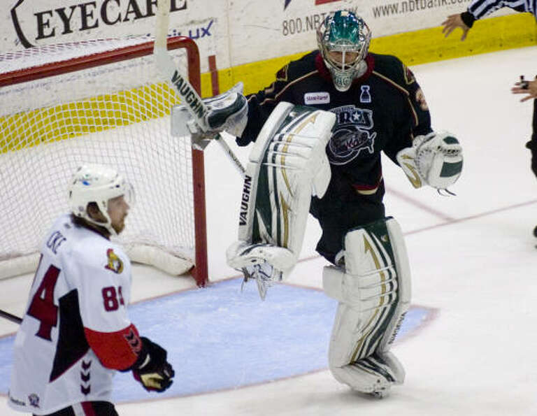 Houston Aeros' (31) Matt Hackett reacts to the 2-1 win over the Binghamton Sentors.