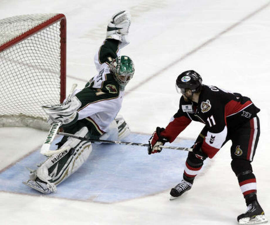 Aeros goalie Matt Hackett stops a shot from Binghamton Senators right wing Erik Condra in the second period. Photo: Cody Duty, Chronicle