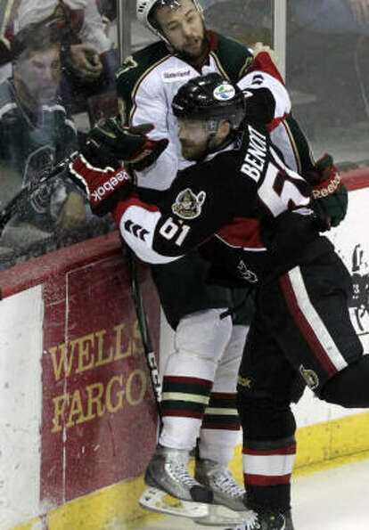 Binghamton Senators defenseman Andre Benoit collides with Aeros left wing Colton Gillies in the the