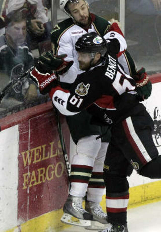 Binghamton Senators defenseman Andre Benoit collides with Aeros left wing Colton Gillies in the the third period. Photo: Cody Duty, Chronicle