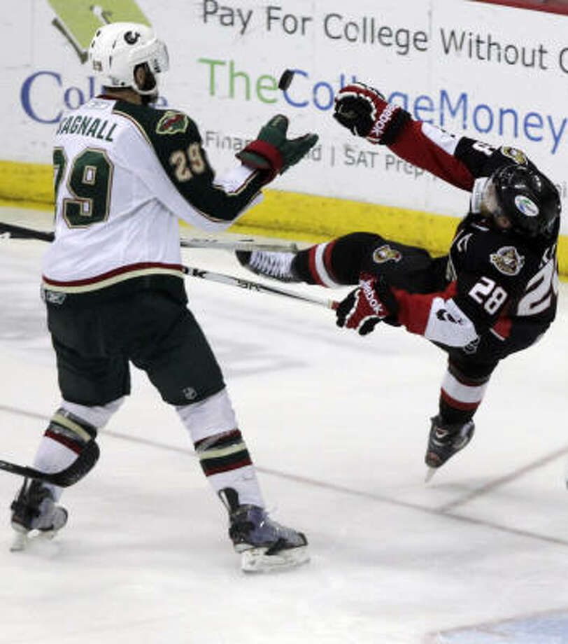 Aeros defenseman Drew Bagnall (29) reaches for the puck as Binghamton Senators right wing Ryan Keller loses his balance in the third period. Photo: Cody Duty, Chronicle