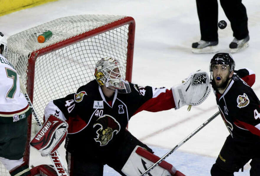 Binghamton Senators goalie Robin Lehner (40) reaches for the puck after a shot by Aeros center Casey