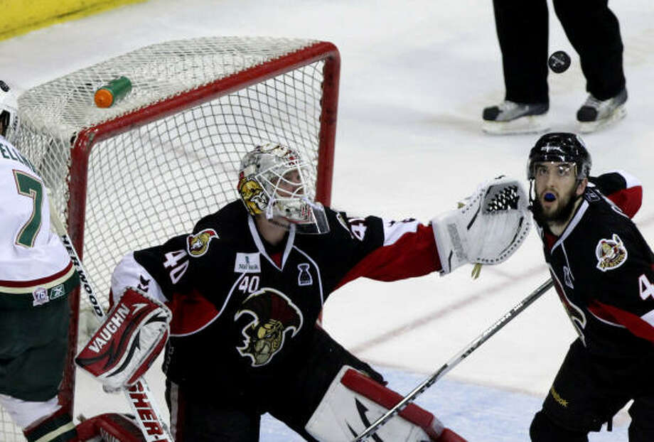 Binghamton Senators goalie Robin Lehner (40) reaches for the puck after a shot by Aeros center Casey Wellman bounced off his glove as defenseman Jared Cowen (4) looks on in the third period. Photo: Cody Duty, Chronicle