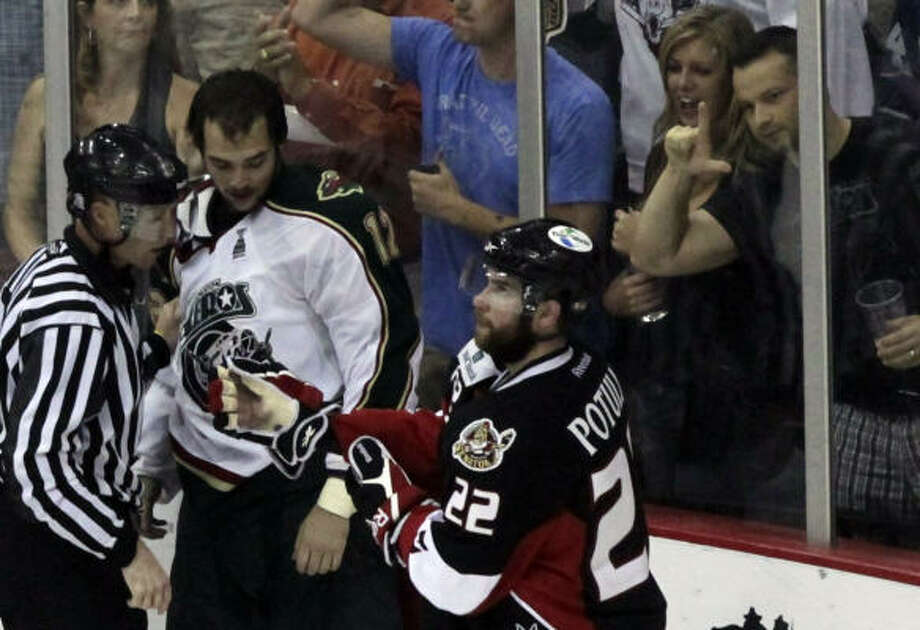 An Aeros fan taunts Senators center Ryan Potulny (22) after the Aeros won 3-1. Photo: Cody Duty, Chronicle